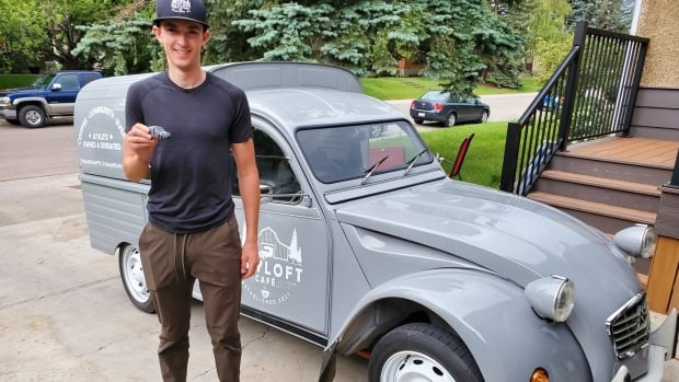 National team speed skater sells coffee in Calgary out of antique Citroën truckette