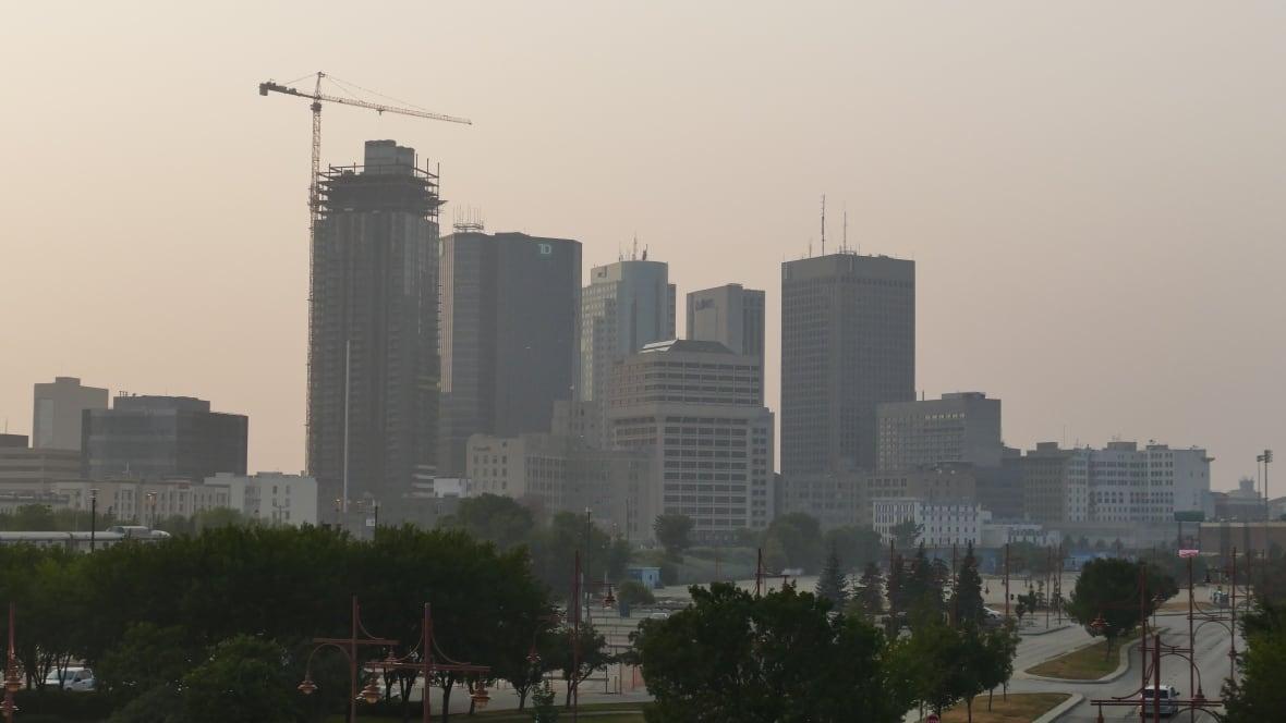 https://i.cbc.ca/1.6109215.1626748452!/fileImage/httpImage/image.jpg_gen/derivatives/original_1180/smoke-from-nearby-forest-fires-creates-a-haze-over-winnipeg.jpg