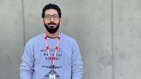 Hassan Al Kontar with Red Cross work badge