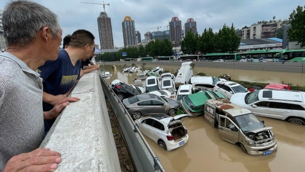 Floods in China kill at least 25, military blasts dam