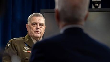 U.S. Gen. Mark Milley looking toward reporters in Arlington, Va.