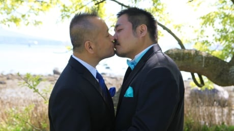 Steven Hashimoto, left, and Tyler Iwata kissed at wedding in 2012