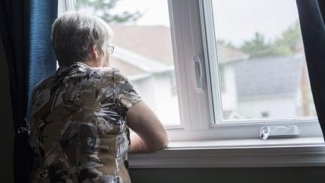 Senior at window