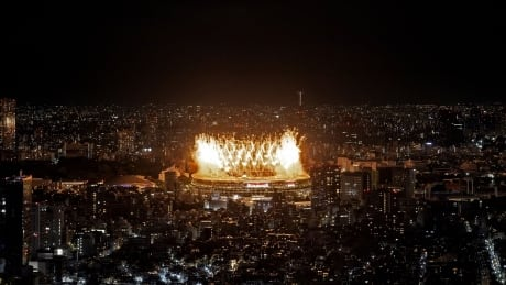 Fireworks light up the sky over Tokyo's Olympic Stadium during the open