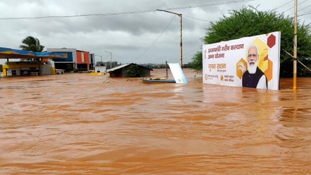 Rescue teams struggle to reach submerged homes in India following flooding, landslides | CBC News