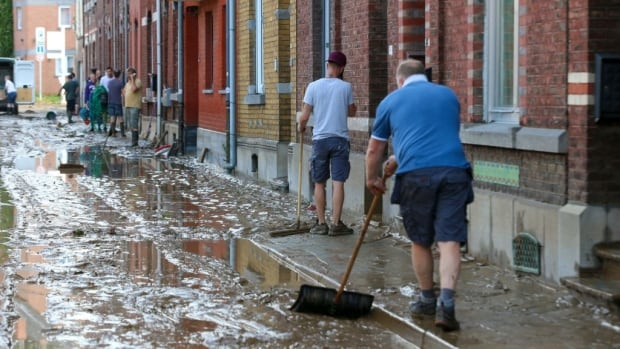 Belgians reeling after more heavy flooding rips apart streets, washes away cars