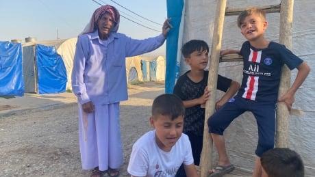 Yazidi children play in the Esyan camp in northern Iraq