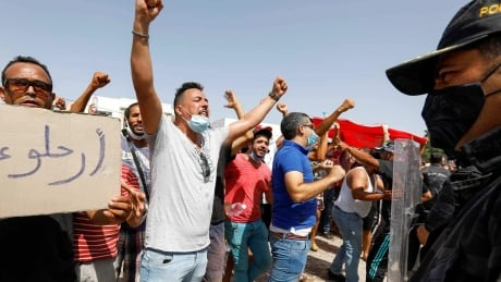 Tunisian president ousts officials amid protests and COVID-19 crisis