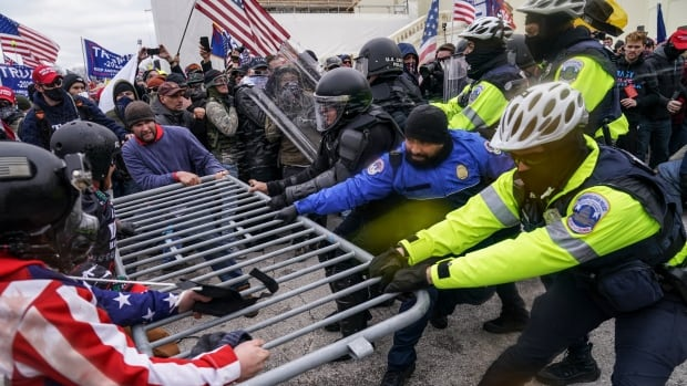 Dramatic video at listening to exhibits brutality of U.S. Capitol riot | CBC Information