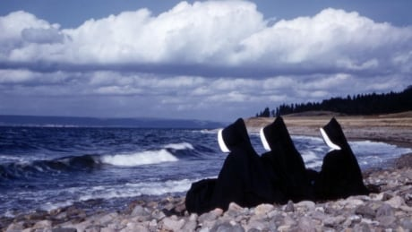 Three Sisters of Charity watch the ocean in this 1957 photo. Members of the organization ran the Shu