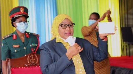 Tanzanian President Samia Suluhu Hassan with vaccination certificate