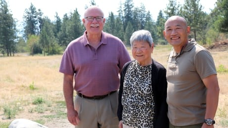 Adrian Marr, right, and his mother Ann Marr with West Kelowna Mayor Gord Milsom