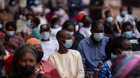 People line up at Dakar's Leopold Sedar Senghor stadium, so they can be vaccinated