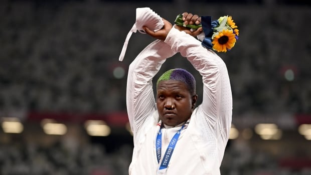 'Where all people who are oppressed meet': U.S. shot putter gestures atop Olympic podium | CBC Sports