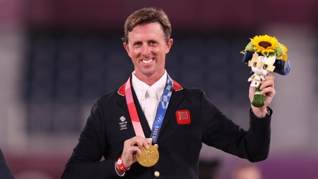 Britain's Ben Maher wins Olympic show jumping gold