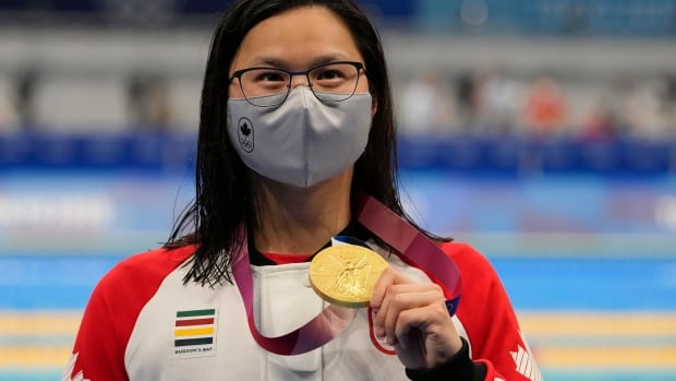 Do athletes get money for medals? Why do divers use tiny towels? Your Olympic questions answered