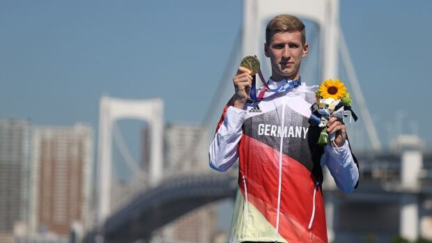 German wins gold medal in men's marathon swimming amid sweltering heat