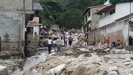 A mud-covered street in Tovar, Venezuela, following flash flooding