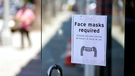 Sign in L.A.'s Farifax district advises shoppers masks are required inside