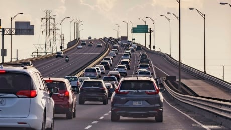 Vehicles driving out of New Orleans along an Interstate highway ahead of Hurricane Ida's arrival