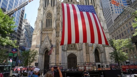 Large flag is raised outside St. Patrick's Cathedral in New York on 20th anniversary of 9/11 attacks