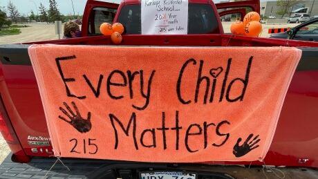 Car procession for 215 lost children