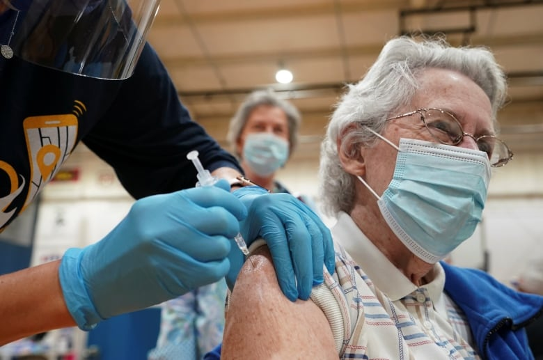 , Frustration grows among health workers in America's least-vaccinated state | CBC News,