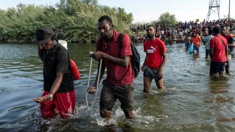 Thousands of migrants converge near Texas bridge in latest U.S. border challenge