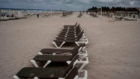 A line of empty beach chairs in Varadero, Cuba, as seen in March 2021