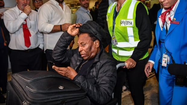 Brazilian soccer great Pele back in hospital after step back in recovery from surgery