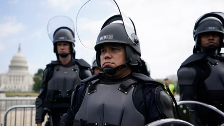 Police with riot gear stand guard at U.S. Capitol on Sept. 18, 2021