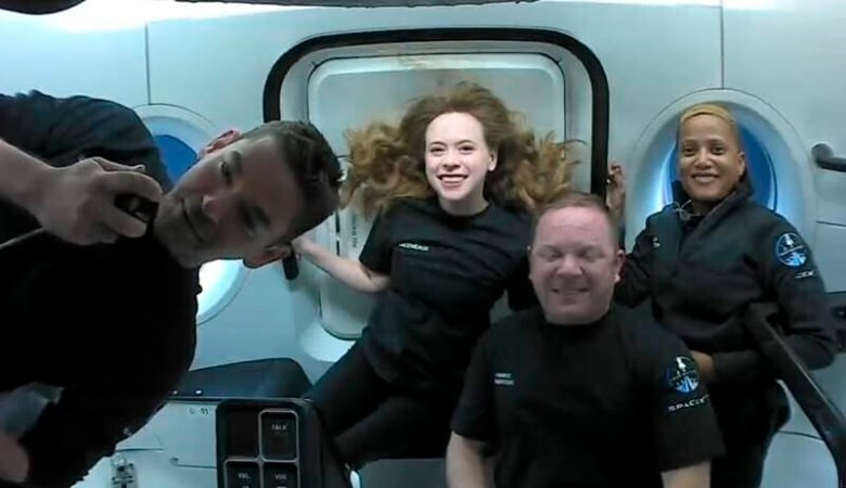 Citizen astronauts in SpaceX capsule safely leap down from Florida