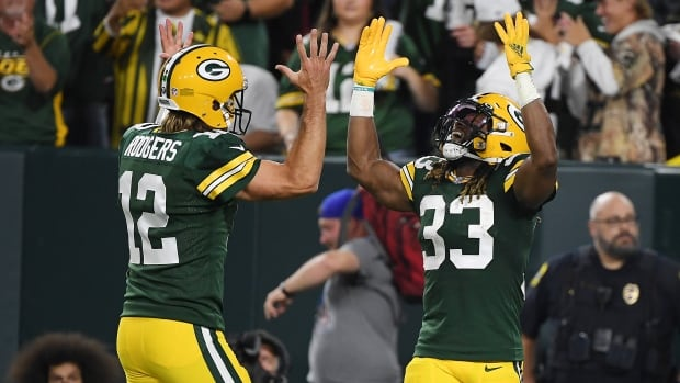 Packers light up Lions en route to 1st win of the season | CBC Sports