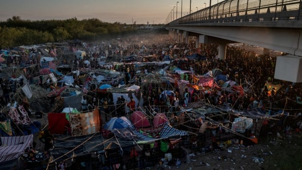 American political battle over immigration reaches a boiling point under a Texas bridge