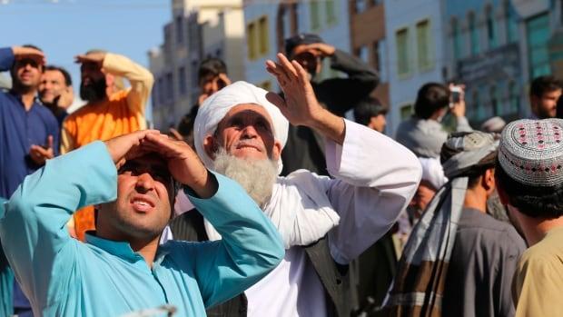Taliban hang body in Afghan city square, as grip of hardline rule looms