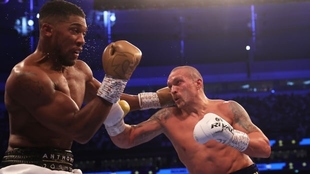 Usyk stuns Joshua with unanimous decision victory to become unified heavyweight champion