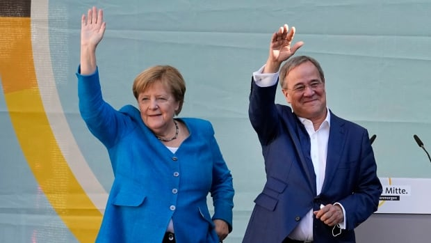 Angela Merkel backs fellow party member for chancellor ahead of tight German vote