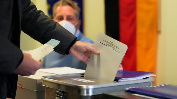 Early German exit polls show Merkel's centre-right bloc on track for worst-ever result