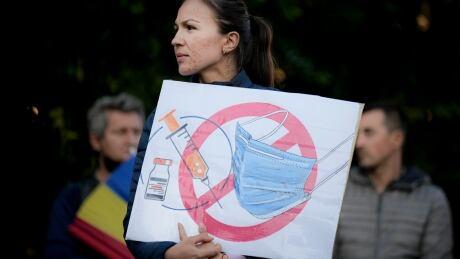 Virus Outbreak Romania Protest