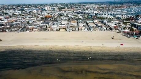 Drone-captured aerial view of post-oil spill beach-side conditions in Newport Beach, Calif.