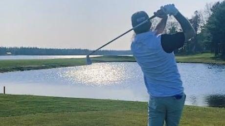 Luke Allen golfing