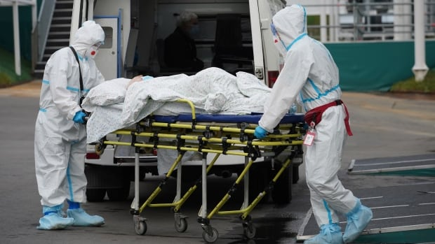 With COVID-19 deaths climbing and hospitals strained, Russia rolls out restrictions