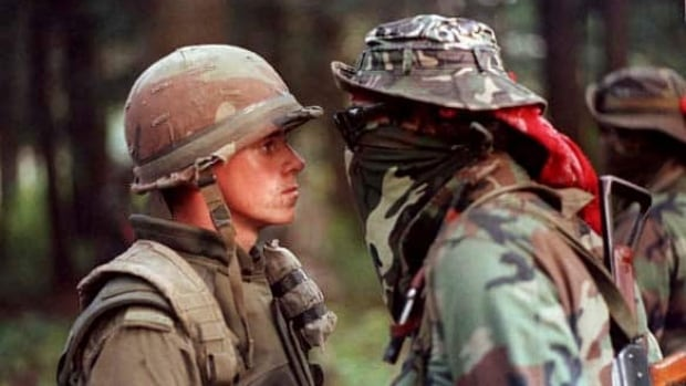 When clashes unfold today, it's not uncommon for people to compare the situation to Oka and the summer of 1990, says Myrna Gabriel of Kanesatake, Quebec. This iconic picture shows Pte. Patrick Cloutier and Mohawk Warrior Brad Larocque, a University of Saskatchewan economics student, facing off during the Oka Crisis in September 1990.